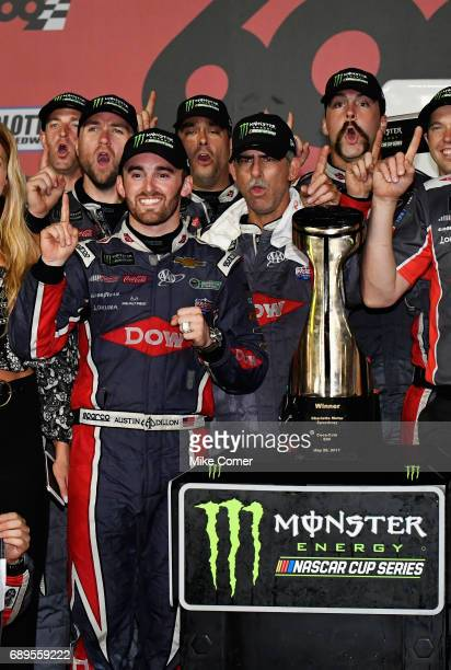Austin Dillon driver of the DOW Salutes Veterans Chevrolet poses with the trophy after winning the Monster Energy NASCAR Cup Series CocaCola 600 at...