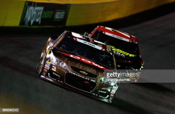 Austin Dillon driver of the DOW Salutes Veterans Chevrolet races Erik Jones driver of the 5Hour ENERGY Extra Strength Toyota during the Monster...