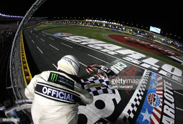 Austin Dillon driver of the DOW Salutes Veterans Chevrolet takes the checkered flag to win the Monster Energy NASCAR Cup Series CocaCola 600 at...