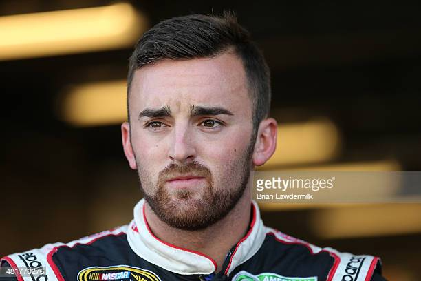 Austin Dillon driver of the Dow/Mycogen Chevrolet stands in the garage area during practice for the NASCAR Sprint Cup Series Crown Royal Presents the...
