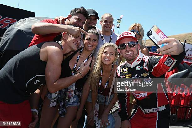 Austin Dillon driver of the Dow/Utility Trailers Chevrolet takes a photo with cast members from reality TV show Vanderpump Rules prior to the NASCAR...