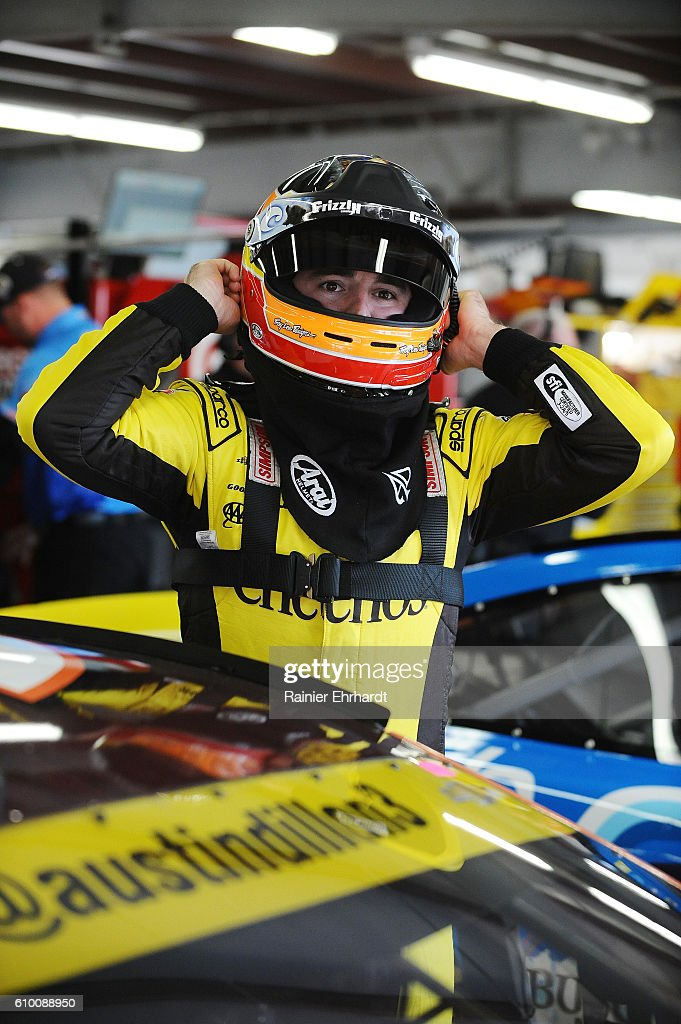 Austin Dillon, driver of the #3 Pumpkin Spice Cheerios Chevrolet, stands in the garage during practice for the NASCAR Sprint Cup Series Bad Boy Off Road 300 at New Hampshire Motor Speedway on September 24, 2016 in Loudon, New Hampshire.