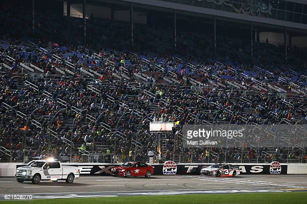 Austin Dillon, driver of the Realtree/Bad Boy Chevrolet, leads the field past the green and yellow flags to start the NASCAR Sprint Cup Series AAA...