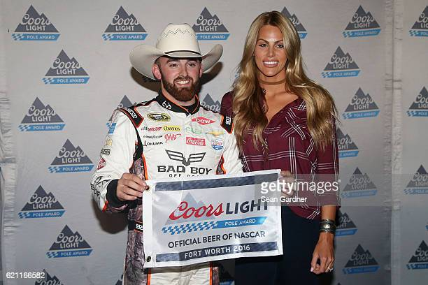 Austin Dillon driver of the Realtree/Bad Boy Chevrolet poses with the Coors Light Pole Award and his girlfriend Whitney Ward after qualifying for the...