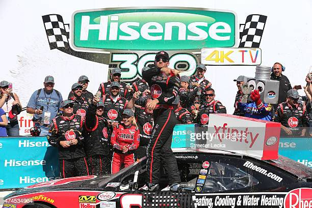Austin Dillon, driver of the Rheem Chevrolet, celebrates in Victory Lane after winning the NASCAR XFINITY Series Hisense 300 at Charlotte Motor...