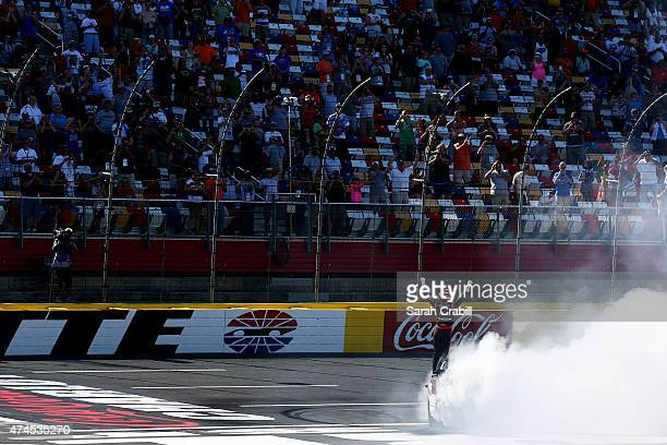 Austin Dillon driver of the Rheem Chevrolet celebrates winning the NASCAR XFINITY Series Hisense 300 at Charlotte Motor Speedway on May 23 2015 in...
