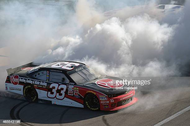 Austin Dillon driver of the Rheem Chevrolet celebrates with a burnout after winning the NASCAR XFINITY Series Boyd Gaming 300 at Las Vegas Motor...