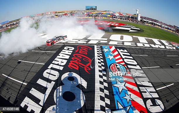 Austin Dillon, driver of the Rheem Chevrolet, celebrates with a burnout after winning the NASCAR XFINITY Series Hisense 300 at Charlotte Motor...