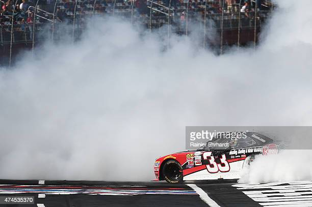 Austin Dillon driver of the Rheem Chevrolet celebrates with a burnout after winning the NASCAR XFINITY Series Hisense 300 at Charlotte Motor Speedway...