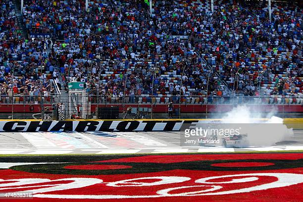 Austin Dillon driver of the Rheem Chevrolet celebrates with a burnout after winning during the NASCAR XFINITY Series Hisense 300 at Charlotte Motor...