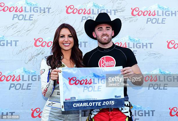 Austin Dillon driver of the Rheem Chevrolet poses with Miss Coors Light Amanda Mertz and the Coors Light Pole award after qualifying for pole...