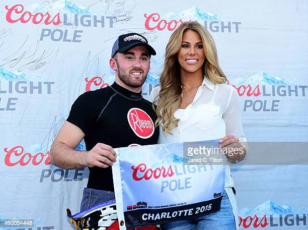 Austin Dillon driver of the Rheem Chevrolet poses with the Coors Light Pole Award and his girlfriend and Titans cheerleader Whitney Ward after...