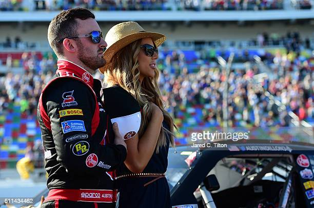 Austin Dillon driver of the Rheem Chevrolet stands on the grid with his girlfriend Whitney Ward prior to the NASCAR XFINITY Series PowerShares QQQ...