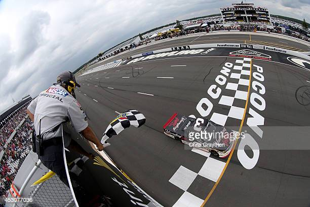 Austin Dillon, driver of the Yuengling Light Lager Chevrolet, crosses the finish line to win the NASCAR Camping World Truck Series Pocono Mountains...