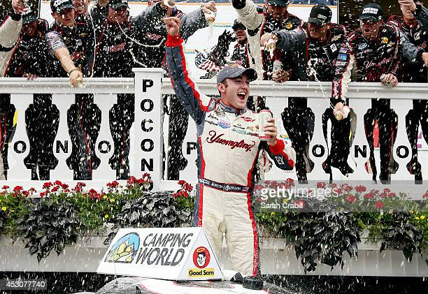 Austin Dillon, driver of the Yuengling Light Lager Chevrolet, celebrates in Victory Lane after winning the NASCAR Camping World Truck Series Pocono...