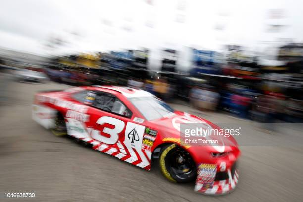 Austin Dillon drives the AAA Chevrolet through the garage area during practice for the Monster Energy NASCAR Cup Series Gander Outdoors 400 at Dover...