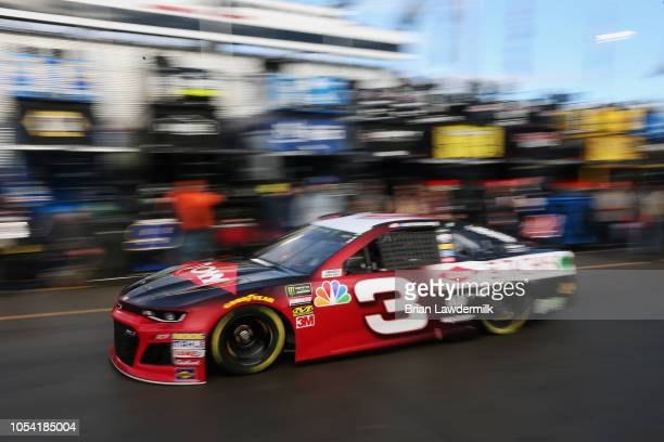 Austin Dillon drives the Dow Chevrolet through the garage area during practice for the Monster Energy NASCAR Cup Series First Data 500 at...