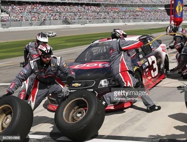 Austin Dillon's crew services his car on Pit Road during the Clash at Daytona NASCAR race on Sunday, Feb. 19, 2017 at Daytona International Speedway...