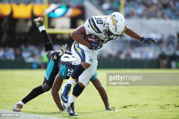 Austin Ekeler of the Los Angeles Chargers beats Jalen Ramsey of the Jacksonville Jaguars for a 28yard touchdown in the first half of their game at...