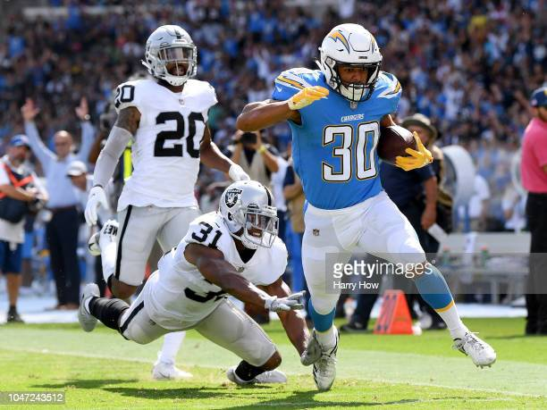 Austin Ekeler of the Los Angeles Chargers beats Marcus Gilchrist and Obi Melifonwu of the Oakland Raiders to score a touchdown to take a 103 lead...