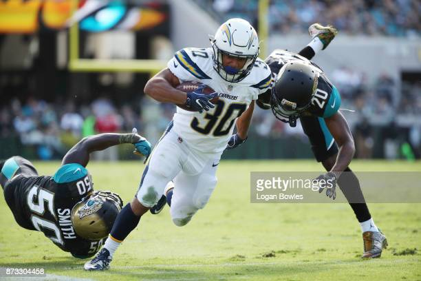 Austin Ekeler of the Los Angeles Chargers beats Telvin Smith and Jalen Ramsey of the Jacksonville Jaguars for a 28yard touchdown in the first half of...