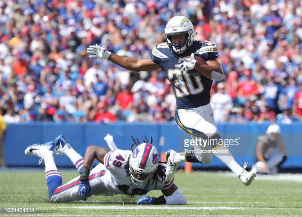 Austin Ekeler of the Los Angeles Chargers gets away from Tremaine Edmunds of the Buffalo Bills during NFL game action at New Era Field on September...