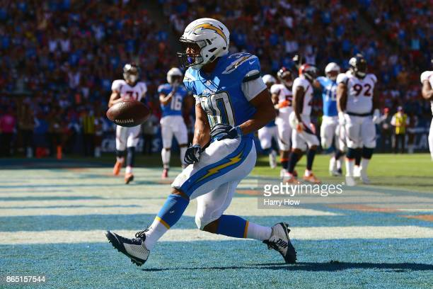 Austin Ekeler of the Los Angeles Chargers reacts after scoring a touchdown making the score 140 during the game against the Denver Broncos at the...