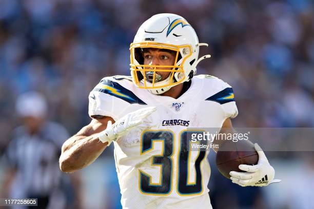 Austin Ekeler of the Los Angeles Chargers runs the ball during a game against the Tennessee Titans at Nissan Stadium on October 20 2019 in Nashville...