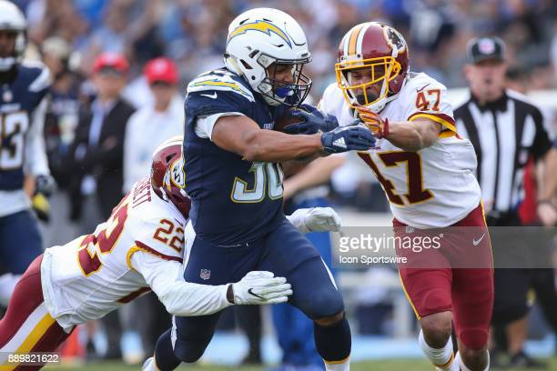 Austin Ekeler of the Los Angeles Chargers runs the ball during a NFL game between the Washington Redskins and the Los Angeles Chargers on December 10...