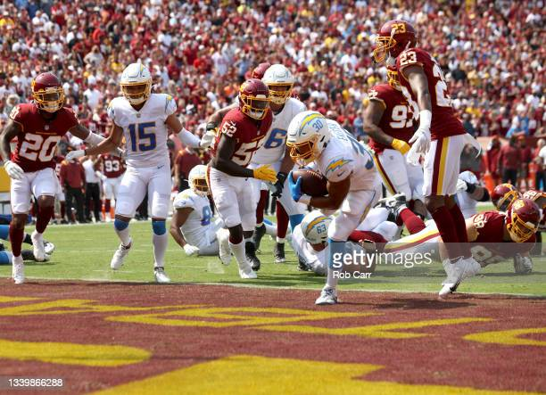 Austin Ekeler of the Los Angeles Chargers scores a touchdown on a 3-yard run against the Washington Football Team during the first quarter at...