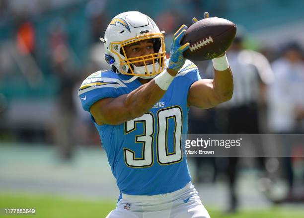 Austin Ekeler of the Los Angeles Chargers warms up prior to the game between the Miami Dolphins and the Los Angeles Chargers at Hard Rock Stadium on...