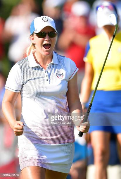 Austin Ernst of Team USA celebrates chipping in on the 15th hole during the second day afternoon fourball matches of The Solheim Cup at Des Moines...