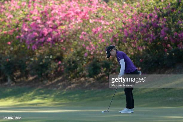 Austin Ernst of the United States putts on the 11th green during the final round of the LPGA Drive On Championship at Golden Ocala Golf Club on March...