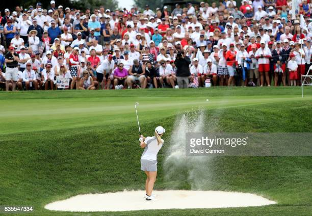 Austin Ernst of the United States Team plays her third shot on the 15th hole in her match with Paula Creamer against Melissa Reid and Emily Pedersen...