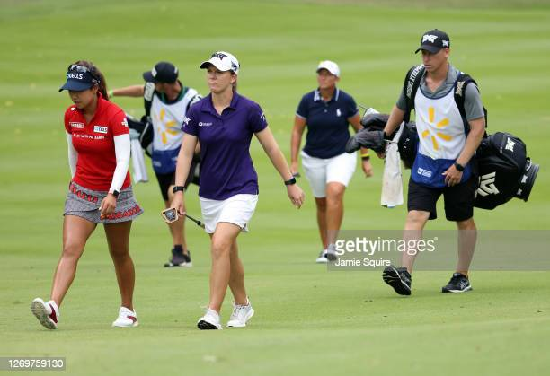 Austin Ernst walks up the fairway with Jenny Shin of Korea and Angela Stanford on the 10th hole during the final round of the Walmart NW Arkansas...