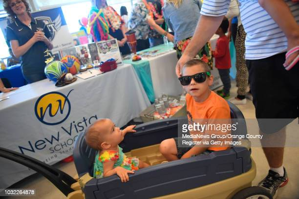 Austin Espinosa of Lake Forest and his sister Ashley at left get towed through the City of Lake Forest's 2nd Annual Special Needs Resource Fair at...