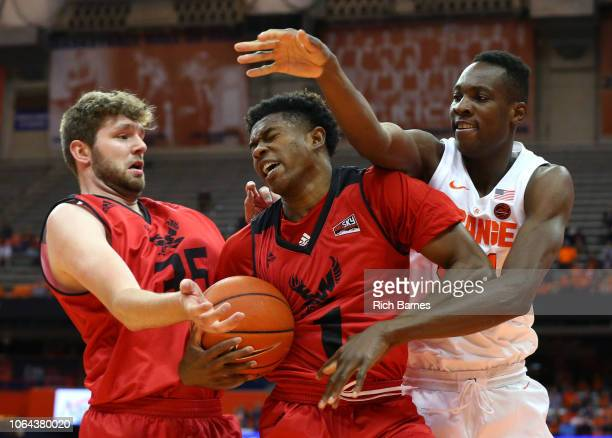 Austin Fadal of the Eastern Washington Eagles controls the ball between Tanner Groves of the Eastern Washington Eagles and Bourama Sidibe of the...