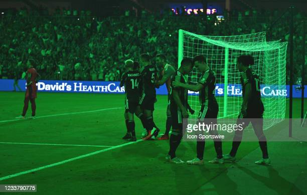 Austin FC players celebrate a goal as the stadium lights up in green to signify the score during MLS game between the Portland Timbers and Austin FC...