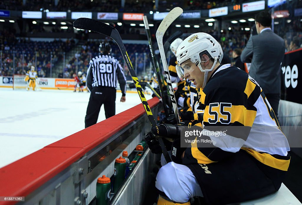 Austin Grzenia #55 of the Kingston Frontenacs catches his breath on the bench during an OHL game against the Niagara IceDogs at the Meridian Centre on September 30, 2016 in St Catharines, Ontario, Canada.