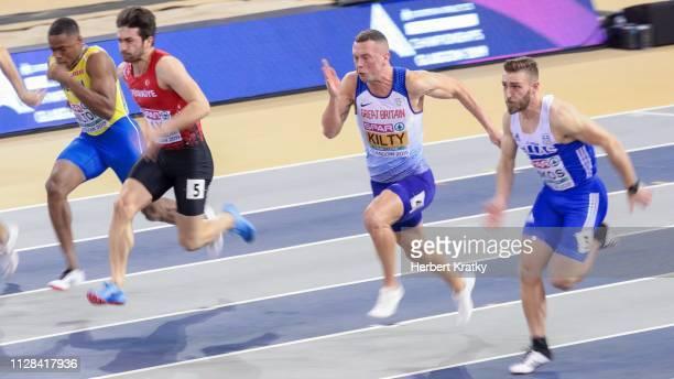 Austin Hamilton of Sweden Ay Aykut of Turkey Richard Kilty of Great Britain and Konstadinos Zikos of Greece compete in the semi finals of the men's...