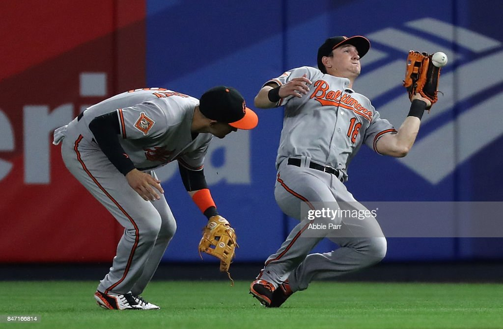 Austin Hays #18 of the Baltimore Orioles misses a catch durring a game against the New York Yankees at Yankee Stadium on September 14, 2017 in the Bronx borough of New York City.