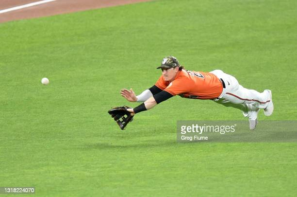 Austin Hays of the Baltimore Orioles tries to catch a single by Tyler Wade of the New York Yankees in the sixth inning at Oriole Park at Camden Yards...