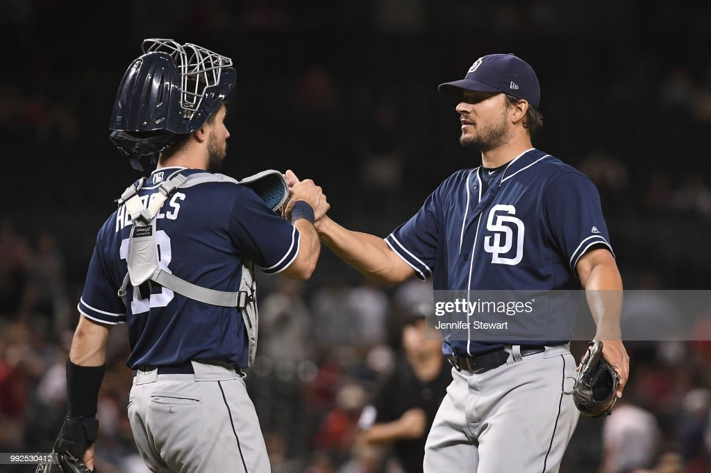 Austin Hedges #18 and Brad Hand #52 of the San Diego Padres celebrate the win over the Arizona Diamondbacks at Chase Field on July 5, 2018 in Phoenix, Arizona. The San Diego Padres won 6-3.