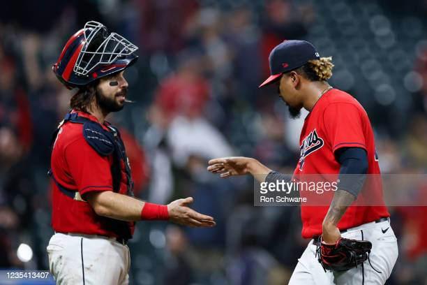 Austin Hedges and Emmanuel Clase of the Cleveland Indians celebrate a 4-1 victory over the Kansas City Royals at Progressive Field on September 21,...