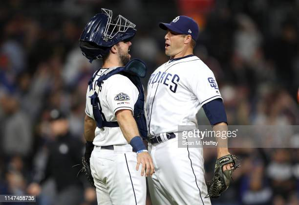 Austin Hedges celebrates with Craig Stammen of the San Diego Padres after defeating the New York Mets 4-0 in a game at PETCO Park on May 06, 2019 in...