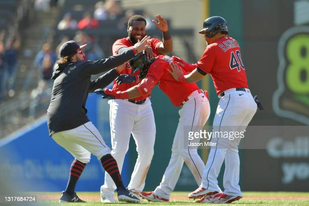 Austin Hedges, Franmil Reyes and Harold Ramirez celebrate with Amed Rosario of the Cleveland after he hit a walk-off RBI single in the tenth inning...