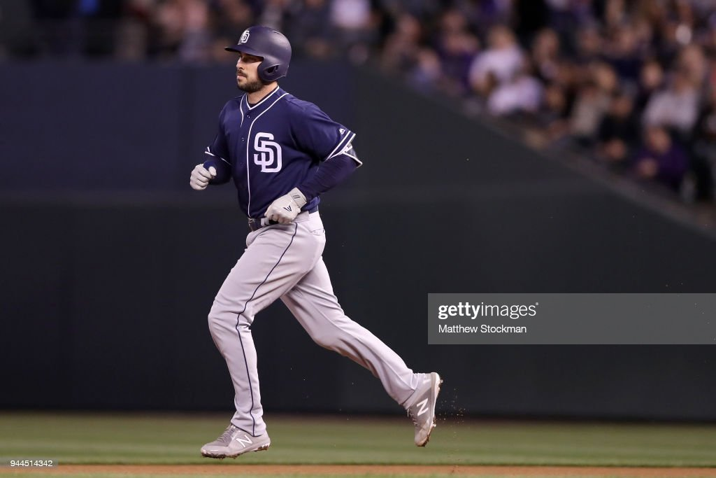 Austin Hedges #18 of the San Diego Padres circles the bases after hitting a solo home run in the fifth inning against the Colorado Rockies at Coors Field on April 10, 2018 in Denver, Colorado.