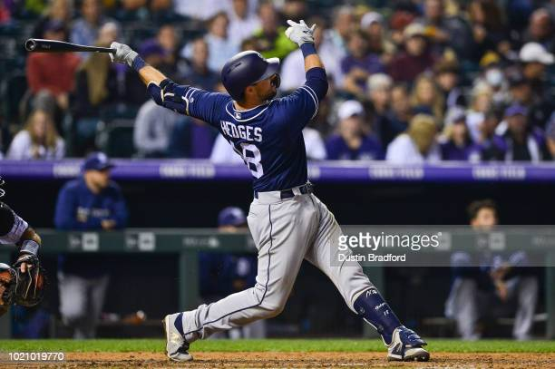 Austin Hedges of the San Diego Padres follows through on a sixth inning solo homerun against the Colorado Rockies at Coors Field on August 21 2018 in...