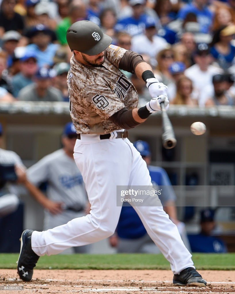 Austin Hedges #18 of the San Diego Padres hits a single during the second inning of a baseball game against the Los Angeles Dodgers at PETCO Park on September 3, 2017 in San Diego, California.