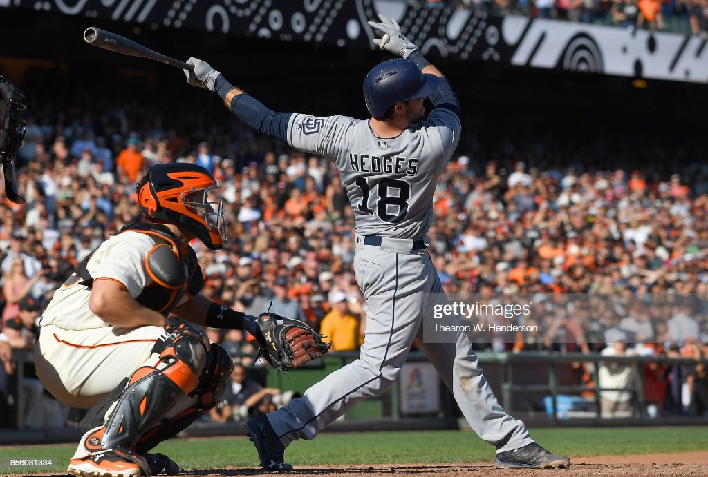 Austin Hedges #18 of the San Diego Padres hits a two-run rbi double against the San Francisco Giants in the top of the ninth inning at AT&T Park on September 30, 2017 in San Francisco, California. The Padres won the game 3-2.